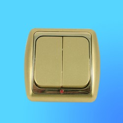Выключатель 2 СП С56-003 АБС метал,зол./зол. рамка, со свет индик. (Ростов)